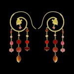 Nassa, golden earrings with stones by Le Sibille on black background