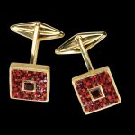 Cassetta, golden cufflinks with stones and micromosaic by Le Sibille, on black background
