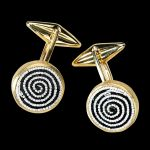 Curl, golden cufflinks with stone and micromosaic by Le Sibille, on black background